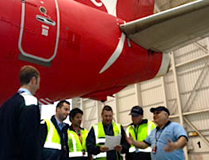 ake off: members at Qantas maintenance take a look at the new union union agrement. Image: http://www.amwu.org.au/
