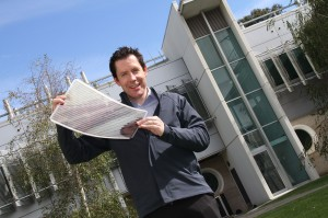 Dr Scott Watkins holding a sheet of flexible solar cells. Image via CSIRO