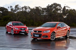 Holden VF Commodore SS V sedan front exterior (Red Hot) and Holden Cruze SRi front exterior (Red Hot)