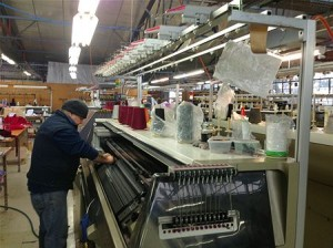 A machine operator at the A and B Knitwear, Merino Gold factory in Brunswick, Victoria Image credit: abc.net.au