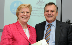 DSTO Chief Defence Scientist Dr Alex Zelinsky and CSIRO Chief Executive Megan Clark sign the agreement. Image credit: CSIRO media release