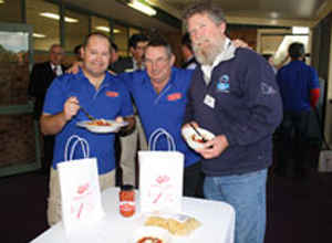 Delicious local flavour: Foods division president Tom Hale (right) enjoys the pasta meal with fellow AMWU men, GV Co-op members Chris Lloyd (centre) and Jason Hefford. Image credit: AMWU