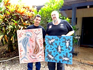 New AMWU organiser Russell Davey (left) shows WA State Secretary Steve McCartney some of his paintings.