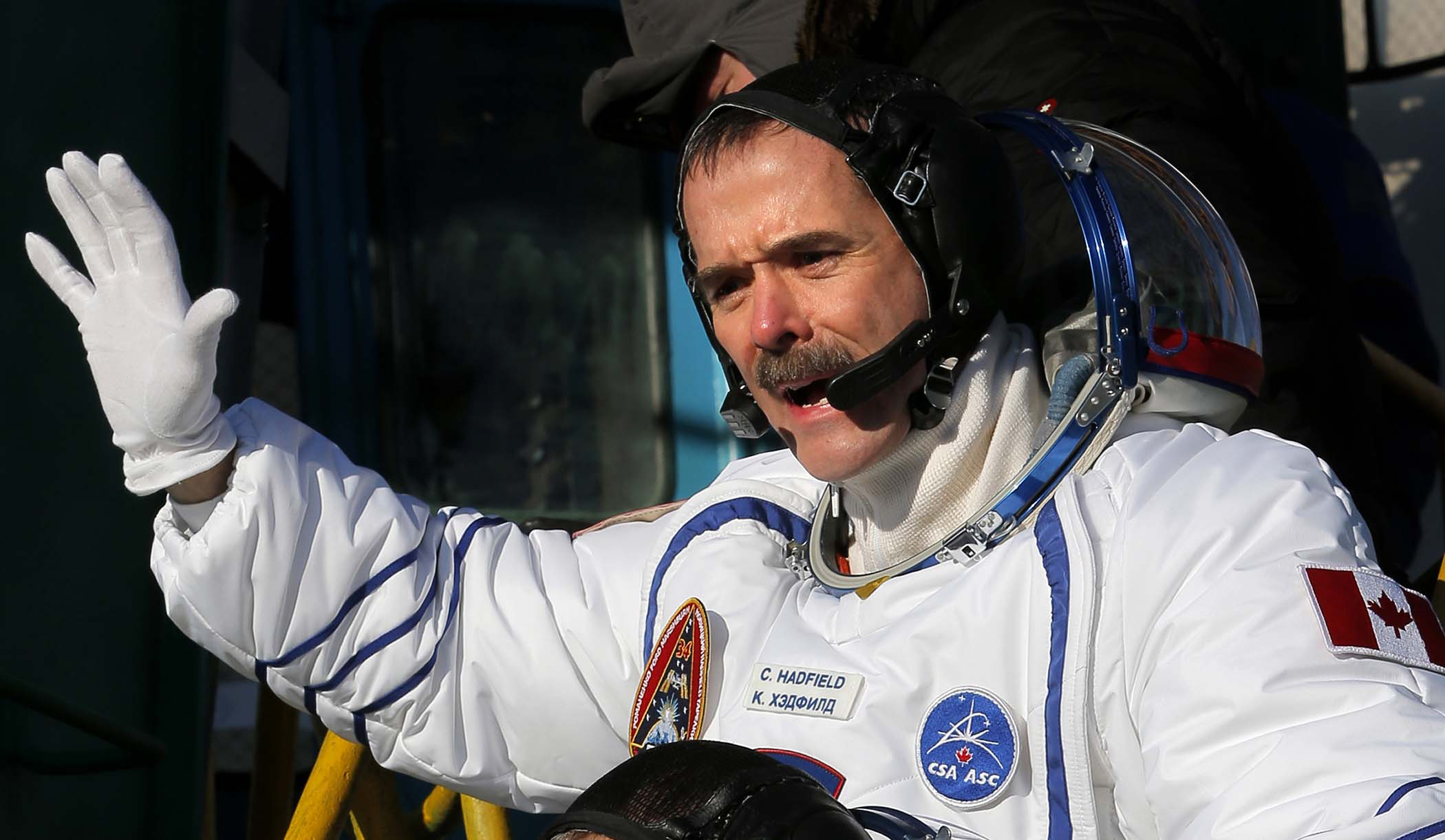 Canadian astronaut Chris Hadfield, a crew member of the mission to the International Space Station, gestures prior to the launch of the Soyuz-FG rocket at the Russian leased Baikonur cosmodrome inKazakhstan, December 19, 2012. (Dmitry Lovetsky/Associated Press) Provided image