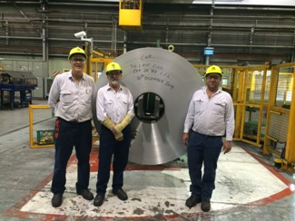 Jan Smith, Les O'Brien and Tim Simmonds pictured with the last coil produced at Point Henry. Les and Tim had the honour of running both the first and last coil on the line. Image credit: Alcoa website