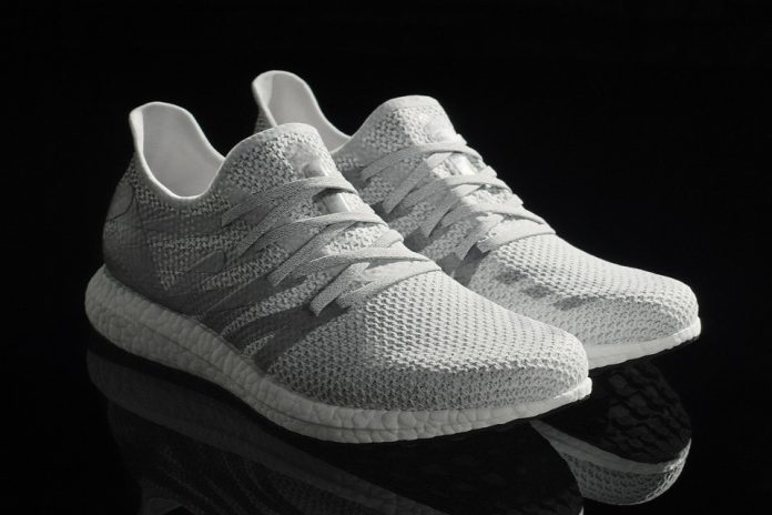 adidas unveils first shoe made almost entirely by robots at